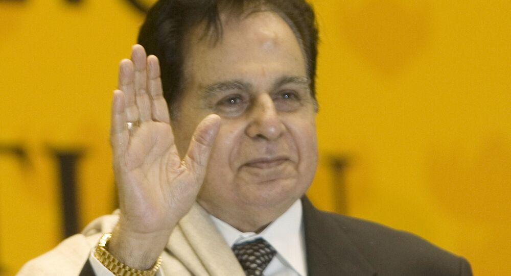 Veteran Bollywood actor Dilip Kumar acknowledges the audience on receiving a Lifetime Achievement award at the 54th National Film Award ceremony in New Delhi, India, Tuesday, Sept. 2, 2008