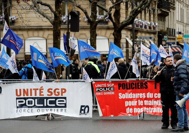 French police officers take part in a demonstration called by several police unions against the government's plans to overhaul the pension system outside the CESE building where French Prime minister is set to unveil later today the details of the reform plan, on December 11, 2019 in Paris