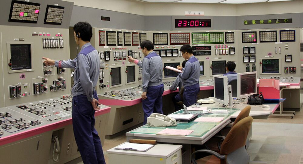 This handout picture taken by Kasai Electric Power Co. (KEPCO) on September 15, 2013 shows KEPCO engineers shutting down its nuclear reactor at the company's Oi nuclear power plant in Oi, Fukui prefecture, western Japan