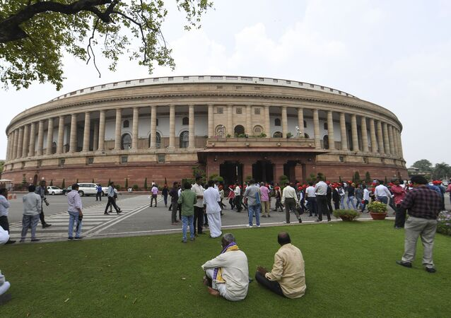 Visitors are seen at the Parliament House in New Delhi