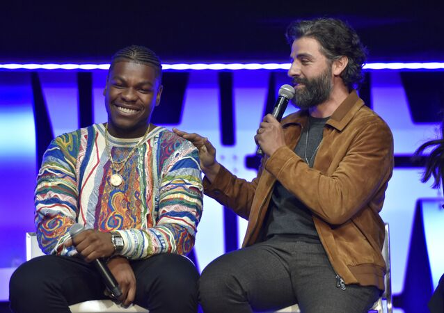 John Boyega, from left, and Oscar Isaac participate during the Star Wars: The Rise Of Skywalker panel on day 1 of the Star Wars Celebration at Wintrust Arena on Friday, April 12, 2019, in Chicago.