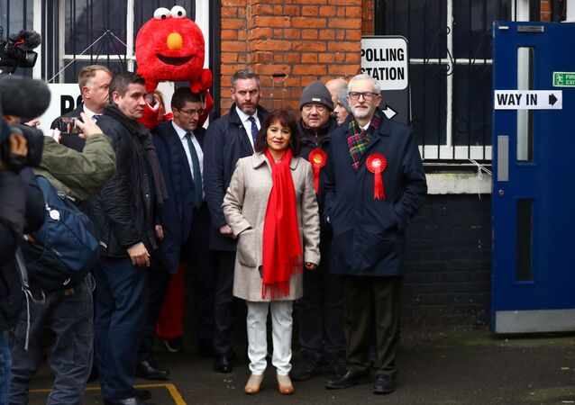 Britain's opposition Labour Party leader Jeremy Corbyn and his wife Laura Alvarez pose outside a polling station during the general election in London, Britain, December 12, 2019