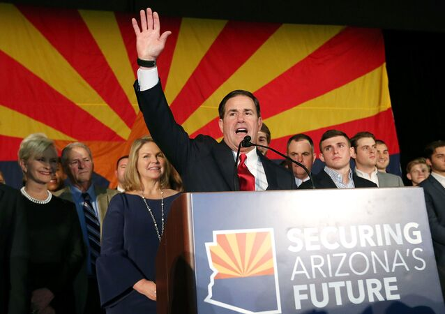 Republican Gov. Doug Ducey celebrates his victory at an election night event for Arizona GOP candidates on 6 November 2018 in Scottsdale, Arizona. Ducey defeated Democratic challenger David Garcia