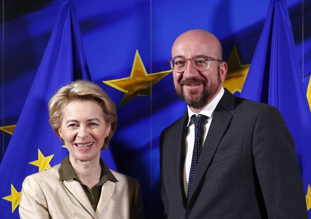 (FILES) In this file photo taken on 2-19 November, European Council President-elect Charles Michel (R) shakes hands with European Commission President-elect Ursula von der Leyen at the Berlaymont building in Brussels