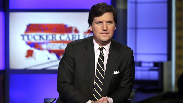FILE - In this March 2, 2017, file photo, Tucker Carlson, host of Tucker Carlson Tonight, poses for photos in a Fox News Channel studio in New York - Sputnik International