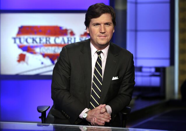 FILE - In this March 2, 2017, file photo, Tucker Carlson, host of Tucker Carlson Tonight, poses for photos in a Fox News Channel studio in New York