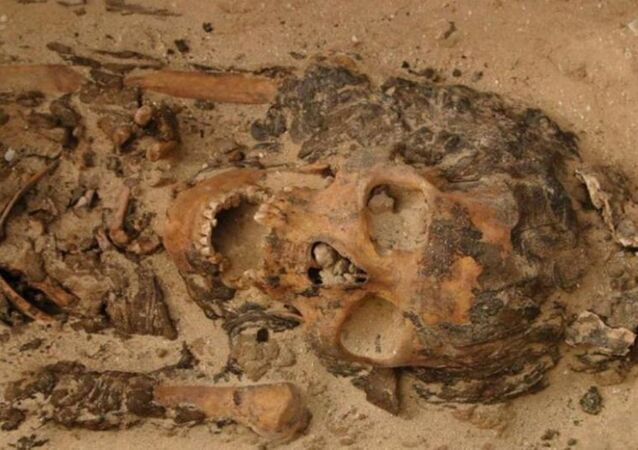 This woman was buried wearing a head cone in a cemetery at the site of Amarna in Egypt