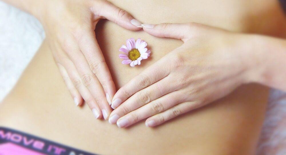 Woman belly flower