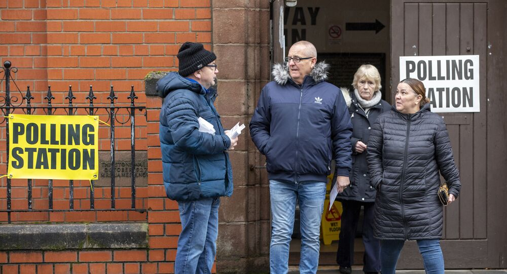Voters leave from a polling station in Belfast, Northern Ireland, as Britain holds a general election on December 12, 2019.