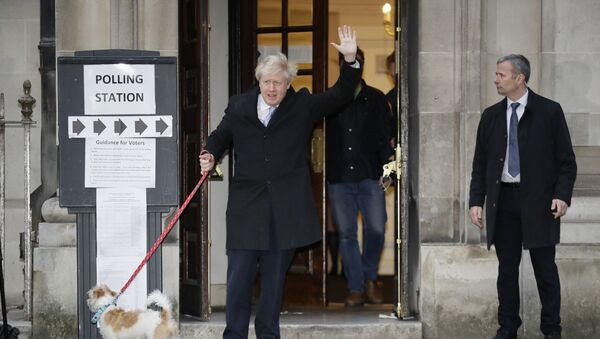 Britain's Prime Minister and Conservative Party leader Boris Johnson with his dog Dilyn leaves after voting in the general election at Methodist Central Hall, Westminster, London, Thursday, Dec. 12, 2019.  - Sputnik International