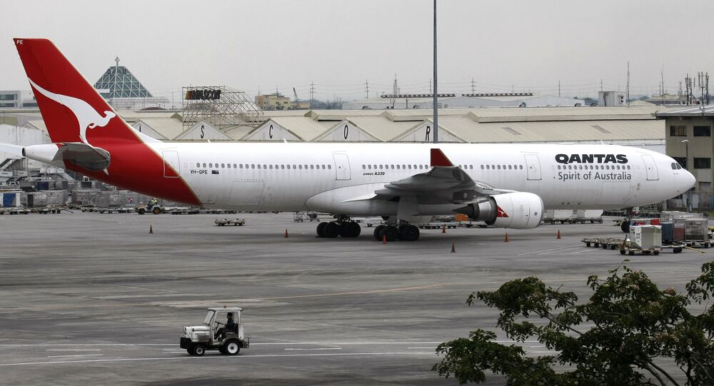 A Qantas Airbus A-330 plane sits on the tarmac at the Ninoy Aquino International Airport Sunday Oct. 30, 2011 at suburban Pasay city, south of Manila, Philippines.