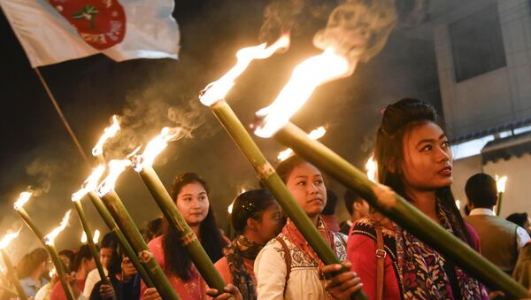 Activists of All Assam Students Union (AASU) take part in a torch light procession to protest against the government's Citizenship Amendment Bill, in Guwahati on December 8, 2019 - Sputnik International