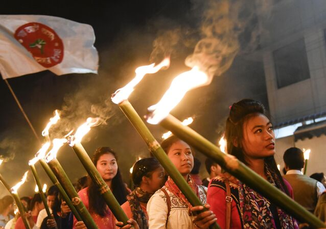 Activists of All Assam Students Union (AASU) take part in a torch light procession to protest against the government's Citizenship Amendment Bill, in Guwahati on December 8, 2019
