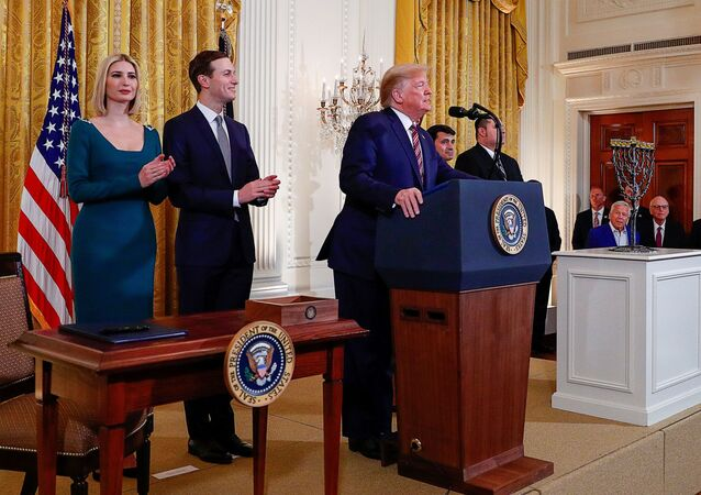 U.S. President Donald Trump is applauded by White House senior advisors Ivanka Trump and Jared Kushner prior to signing an executive order regarding combating anti-Semitism on U.S. college campuses during a during a Hanukkah reception in the East Room of the White House in Washington, U.S., December 11, 2019