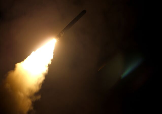 In this image released by the US Department of Defense the guided-missile cruiser USS Monterey fires a Tomahawk land attack missile on April 14, 2018