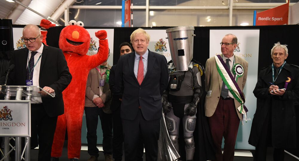 Britain's Prime Minister and Conservative leader Boris Johnson (C) reacts as the results are read out for the race to be MP for Uxbridge and Ruislip South at the count centre in Uxbridge, west London, on December 13, 2019 after votes were counted as part of the UK general election.