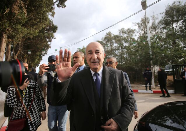 Algeria's presidential candidate Abdelmadjid Tebboune greets attendees during the presidential election in Algiers, Algeria December 12, 2019