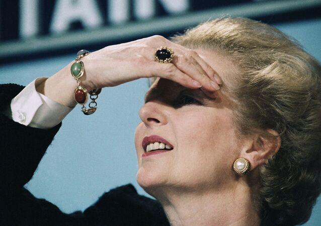 Britain's Prime Minister Margaret Thatcher peers out over her audience during press conference, June 10, 1987 in central London.