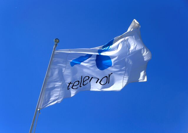 Telenor flag flutters next to the company's headquarters in Fornebu, Norway, June 1, 2017.