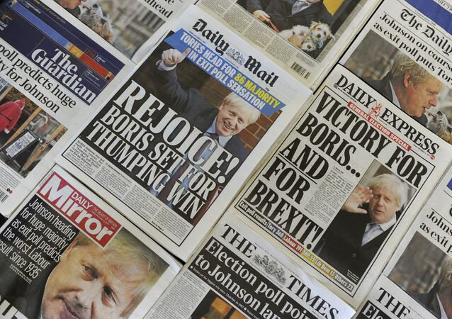 An arrangement of UK daily newspapers photographed as an illustration in London on December 13, 2019 shows front page headlines reporting on the projected election result based on exit polls in the UK general election.