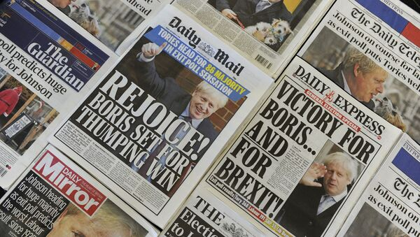 An arrangement of UK daily newspapers photographed as an illustration in London on December 13, 2019 shows front page headlines reporting on the projected election result based on exit polls in the UK general election. - Sputnik International