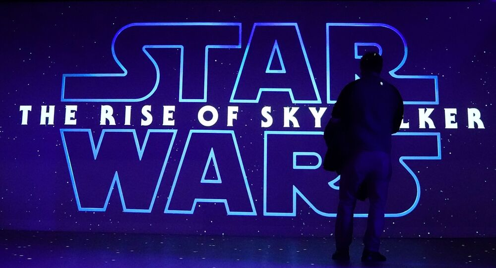 A man watches a trailer for Star Wars: The Rise of Skywalker at the Dolby store in the Manhattan borough of New York City, New York, U.S., December 5, 2019.