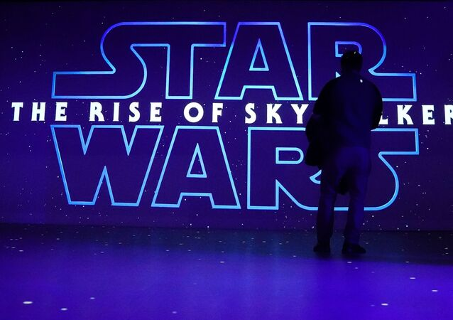 A man watches a trailer for Star Wars: The Rise of Skywalker at the Dolby store in the Manhattan borough of New York City, 5 December 2019.