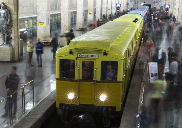 People come to have a look at Soviet-era vintage subway cars parked in the Partizanskaya subway station in Moscow, Russia, Friday, May 15, 2015.