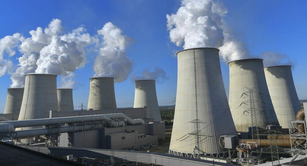 In this Sunday, September 30, 2018 photo water vapour clouds rise from the cooling towers of the Jaenschwalde lignite-fired power plant of Lausitz Energie Bergbau AG (LEAG) in Jaenschwalde, Germany.