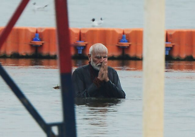 Indian Prime Minister Narendra Modi takes a holy dip at Sangam, the confluence of the rivers Ganges and Yamuna and mythical Saraswati, during the Kumbh Mela festival in Allahabad on February 24, 2019.
