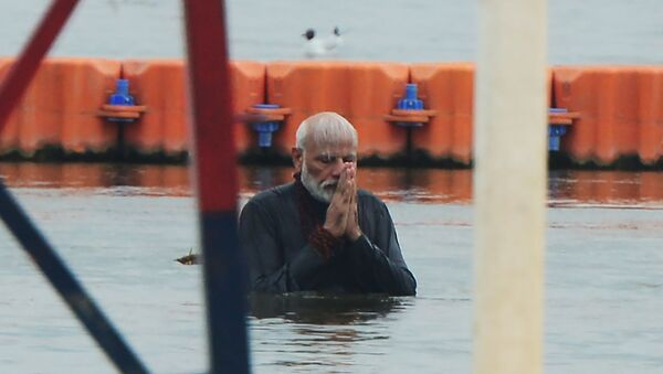 Indian Prime Minister Narendra Modi takes a holy dip at Sangam, the confluence of the rivers Ganges and Yamuna and mythical Saraswati, during the Kumbh Mela festival in Allahabad on February 24, 2019.  - Sputnik International