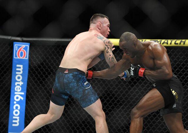 Kamaru Usman (red gloves) fights Colby Covington (blue gloves) during UFC 245 at T-Mobile Arena in Las Vegas.