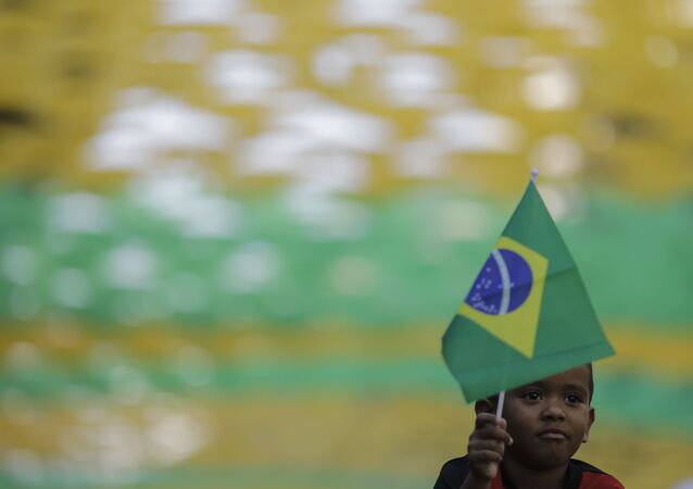 Child Waves a Brazilian Flag