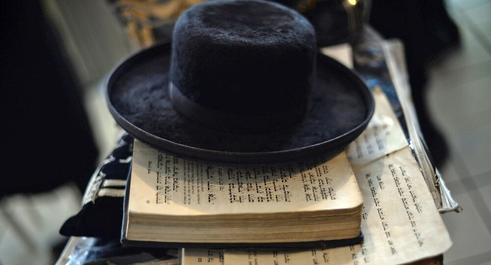 View of a hat and the Torah