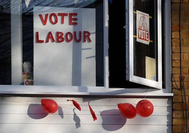 Political election campaign messages and burst balloons are seen at a house in the same street where Labour party leader Jeremy Corbyn lives, in London, Britain, December 14, 2019