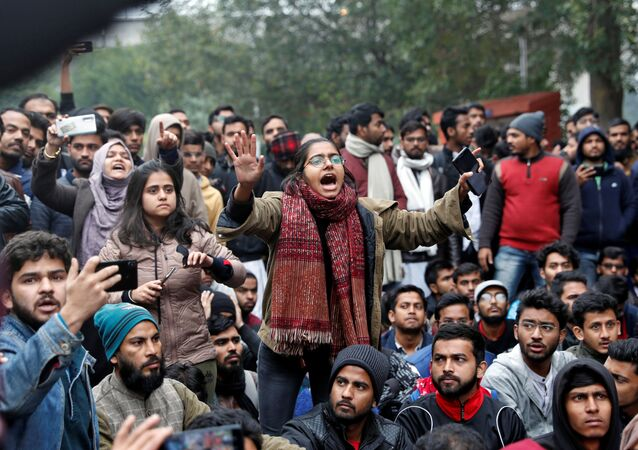 A student of the Jamia Millia Islamia university reacts during a demonstration after police entered the university campus on the previous day, following a protest against a new citizenship law, in New Delhi, India, December 16, 2019