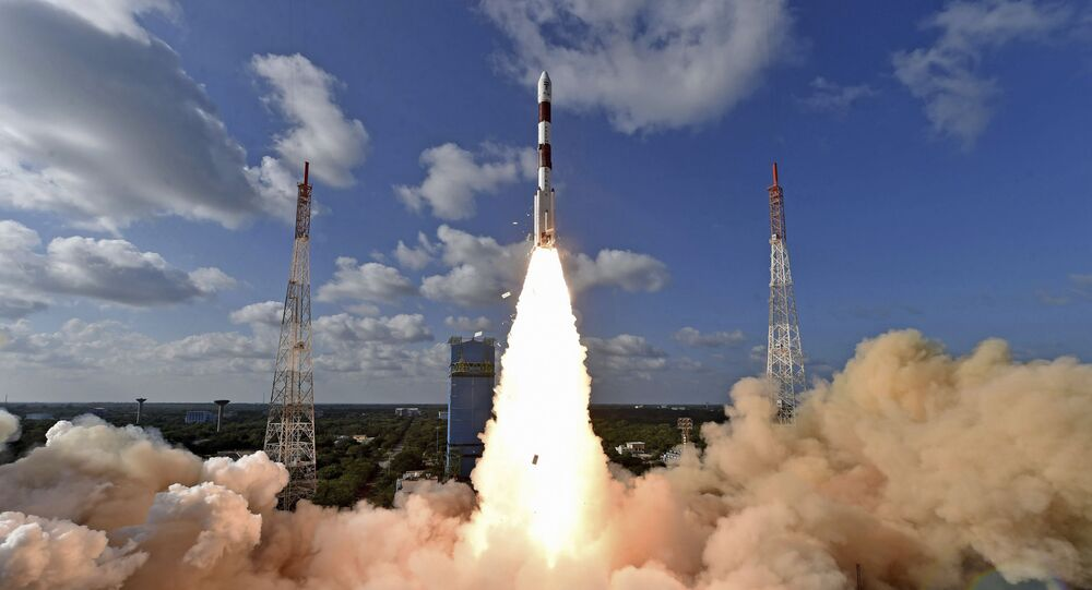 This handout photo provided by the Indian Space Research Organization shows PSLV-C48 lifting off at the Satish Dhawan Space Center in Sriharikota, India, Wednesday, Dec. 11, 2019. India's Polar Satellite Launch Vehicle successfully launched RISAT-2BR1 along with nine commercial satellites, according to a press release. RISAT-2BR1 is a radar imaging earth observation satellite weighing about 628 kg, it said