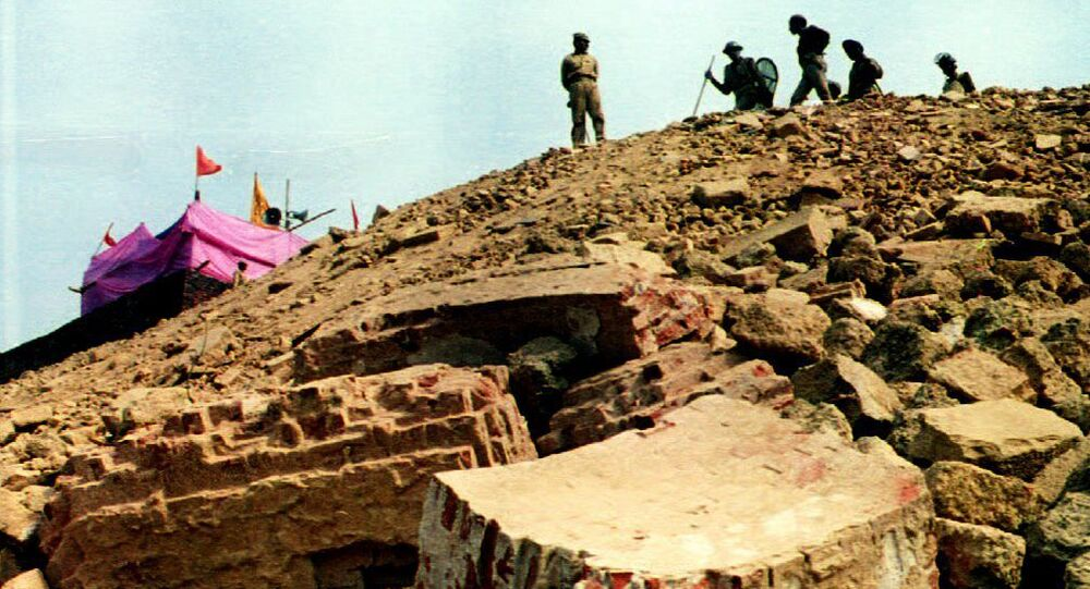 Paramilitary police position themselves on a hill overlooking the ruins of the 16th century Babri mosque (foreground) 08 December 1992 in Ayodhya, India