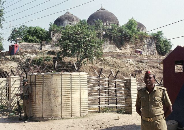 FILE - In this Oct. 29, 1990, file photo, Indian security officer guards the Babri Mosque in Ayodhya, closing off the disputed site claimed by Muslims and Hindus