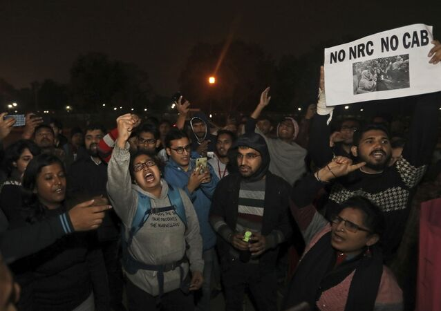 Students shout anti government slogans during a protest at the India Gate against the new citizenship amendment law, in New Delhi, India, Monday, Dec.16, 2019