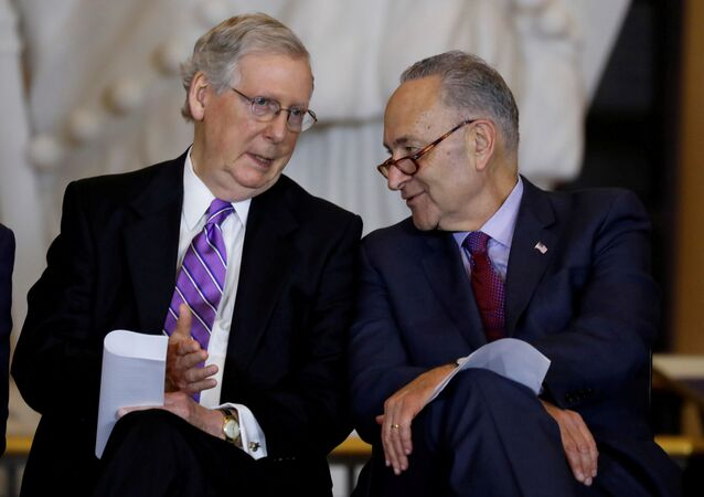 Senate Majority Leader Mitch McConnell and Senate Minority Leader Chuck Schumer talk during a ceremony to present the Congressional Gold Medal to Filipino veterans of the Second World War on Capitol Hill in Washington, U.S., October 25, 2017
