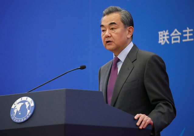Chinese Foreign Minister Wang Yi delivers a speech at an annual symposium on international situation and China's diplomacy in Beijing, China December 13, 2019.