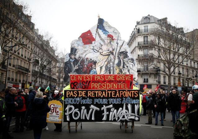 A float with a drawing of the painting La Liberte guidant le peuple (Liberty Leading the People) by Eugene Delacroix is seen during a demonstration against French government's pensions reform plans in Paris as part of a day of national strike and protests in France, December 5, 2019