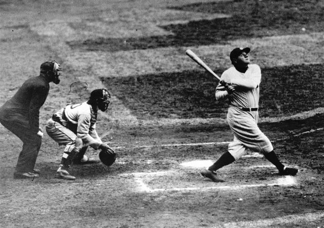 Babe Ruth of the New York Yankees clouts a towering home run