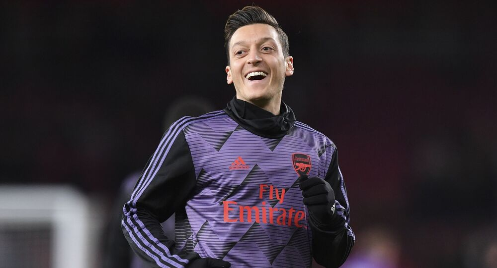 Arsenal's German midfielder Mesut Ozil warms up for the English Premier League football match between Arsenal and Manchester City at the Emirates Stadium in London on December 15, 2019