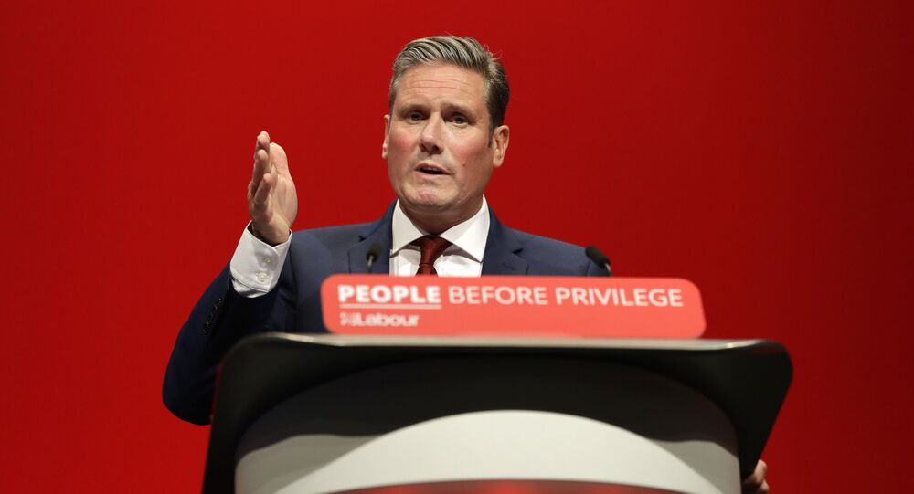 FILE - In this Monday, 23 September 2019 file photo, Britain's Shadow Brexit Secretary Sir Keir Starmer speaks on stage during the Labour Party Conference at the Brighton Centre in Brighton, England.
