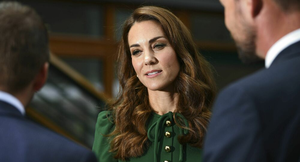 Britain's Kate, the Duchess of Cambridge meets junior players and staff