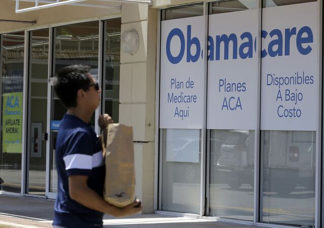 A man walks by a healthcare insurance office in Hialeah, Florida