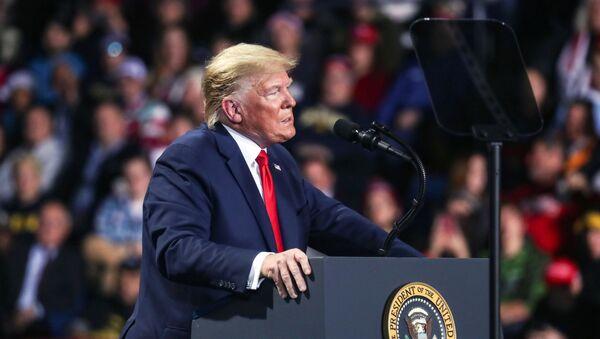 U.S. President Donald Trump reacts while speaking during a campaign rally in Battle Creek, Michigan, U.S., December 18, 2019.  - Sputnik International