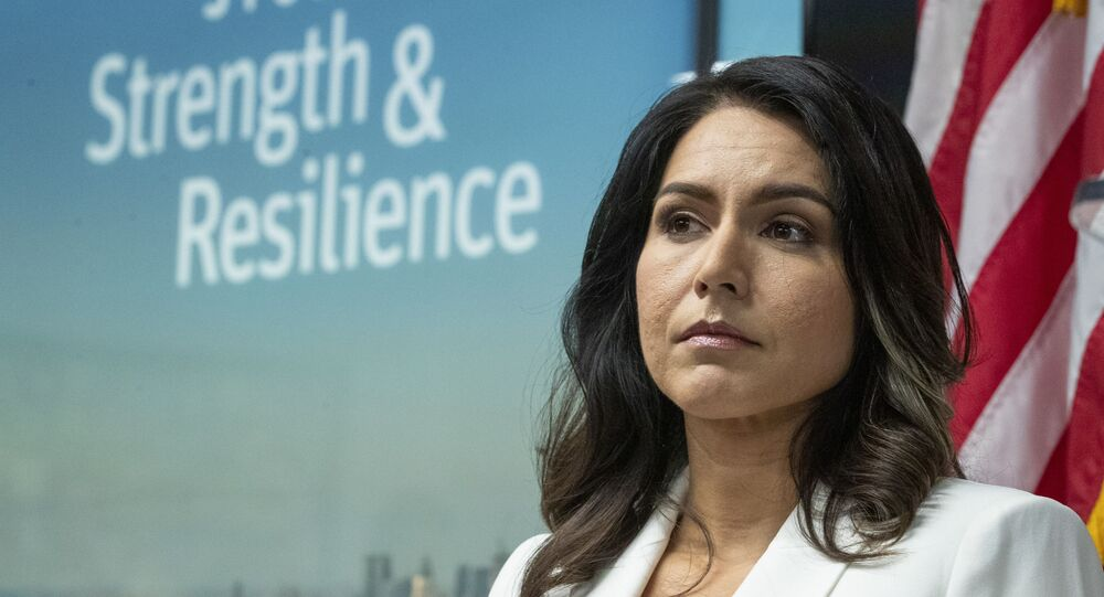 Democratic presidential candidate U.S. Rep. Tulsi Gabbard, D-Hawaii, listens as family members of victims of the terrorist attacks on 9/11 speak during a news conference at the 9/11 Tribute Museum on 29 October 2019, in New York.